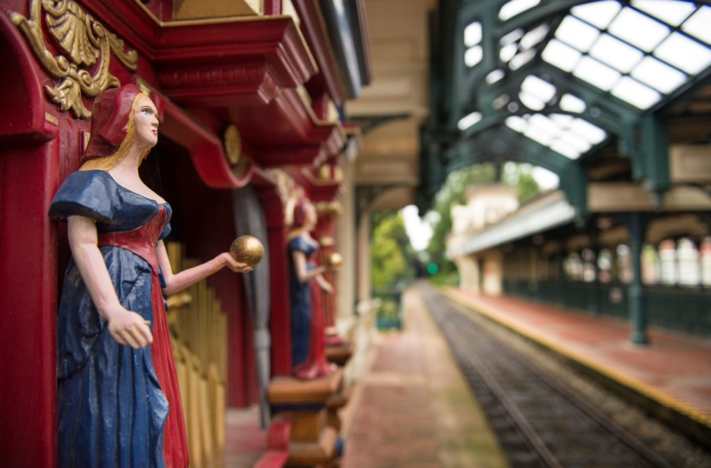 Architectural detail of the Main Street usa guard, a statue holds a golden ball in the hand