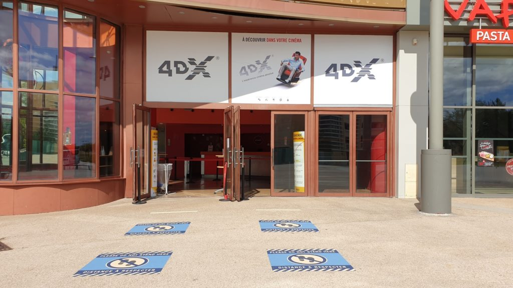 At the entrance to the cinema, markings have been placed on the floor for social distancing.