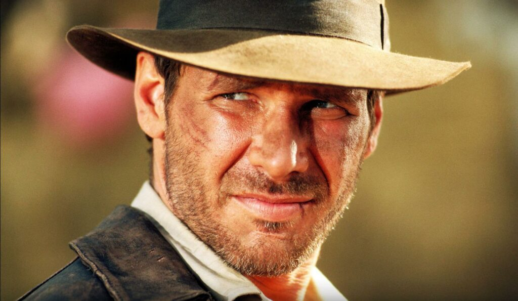 Indiana Jones, played by actor Harrison Ford, wearing his leather jacket and hat