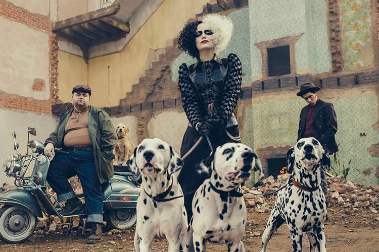 Cruella holding Dalmatians on a leash and surrounded by Jasper and Horace